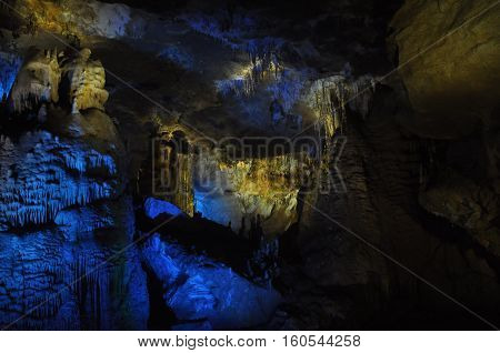 Prometheus Cave. Georgia. Stalactites and stalagmites highlighted colors.