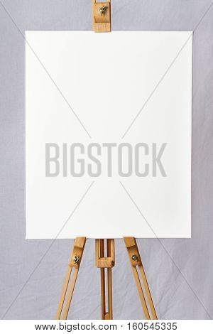 Blank canvas on an wooden easel ready for your own design