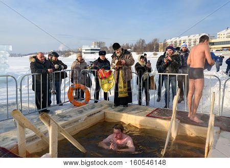 Priest Consecrates The Ice Hole On Epiphany Day. Russia