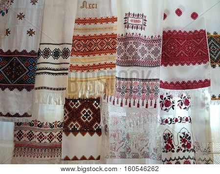 Many Ukrainian national towels with embroidered hanging on a rope