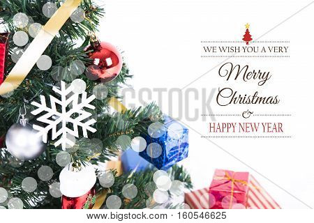 Christmas decorative with gift box and snowflake on christmas tree with Merry Christmas and Happy New Year 2017 text on white background.