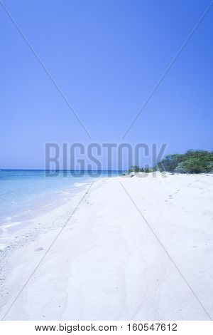 clean white sand beach meeting the blue sky and sea on palawan island in the philippines