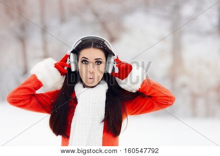 Surprised Winter Woman With Wireless Headphones Outside
