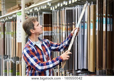 Man Chooses Metal Plates For Thresholds In A Store