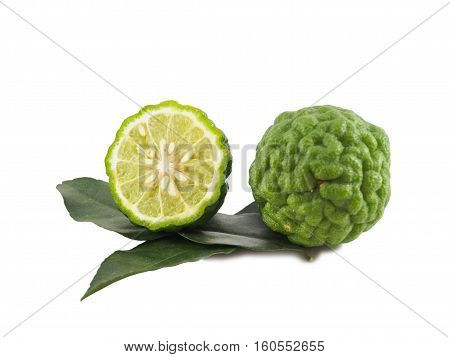 Fresh bergamot (kaffir lime) slice with leaf isolated on white background