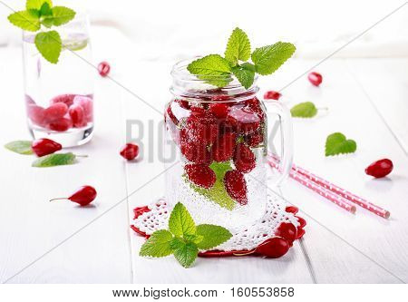 Fruit infused water. Detox water with dogwood and mint.