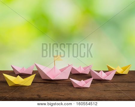 Many paper boat ( origami boat) on wooden table for decoration and toy for childen of natural background