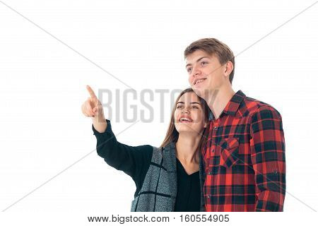 close up of fun young stylish couple in love having fun in studio isolated on white background