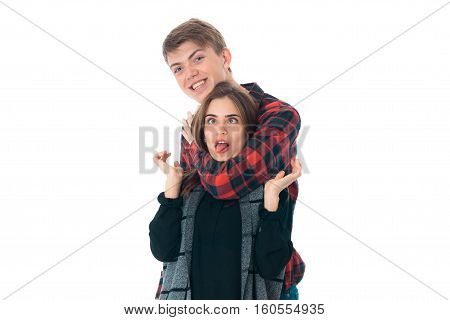 close up of amazing young stylish couple in love having fun in studio isolated on white background