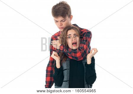 close up of gorgeous young stylish couple in love having fun in studio isolated on white background