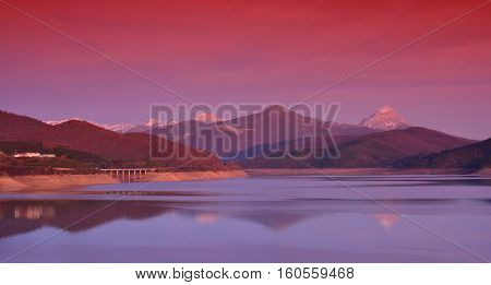 Sunset dam in Leon, Spain with reflections and reddish tones