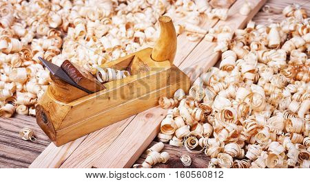 Wooden planer, natural building material, handcrafted wood, carrying out carpentry, joinery tools, wood sawdust