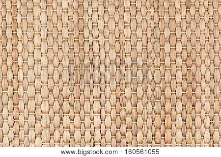 Bamboo woven beige mat handmade background. Wicker wood texture. Vertical strips.