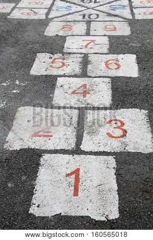 Hopscotch - popular street game/  Hopscotch at street