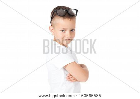 child- boy with glasses - in a white t-shirt - holding glasses.