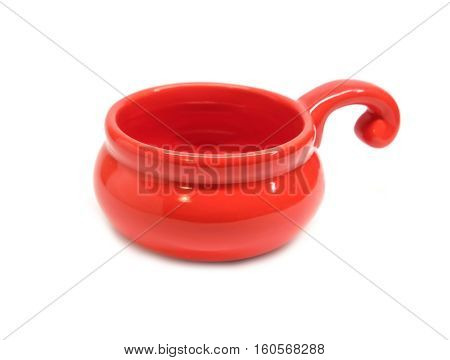 Single small clay empty red cocotte isolated on white front view closeup