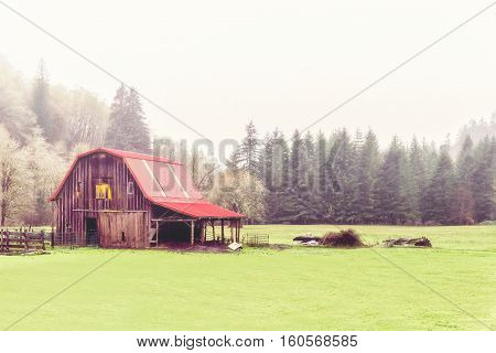 Red barn on a cloudy and rainy day in the Pacific northwest
