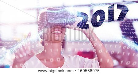 Digital image of new year 2017 against digitally generated binary code landscape