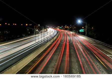 Light trails over H1 freeway in Honolulu, Hawaii at night