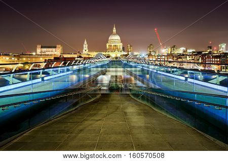St Paul's Cathedral During Night From The Millennium Bridge Over River Thames, London, United Kingdo