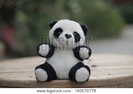Doll. Panda. objectk and white stuffed panda. Dolls made of fabric for children.