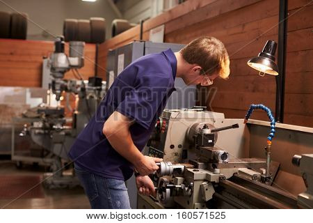 Male Engineer In Factory Using Milling Machine