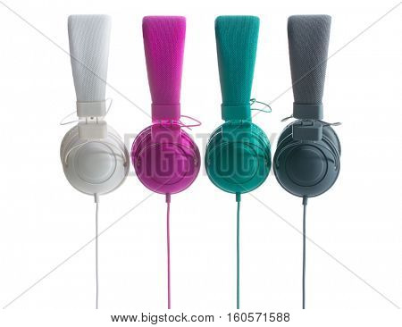 Different colors headphones isolated on white background.