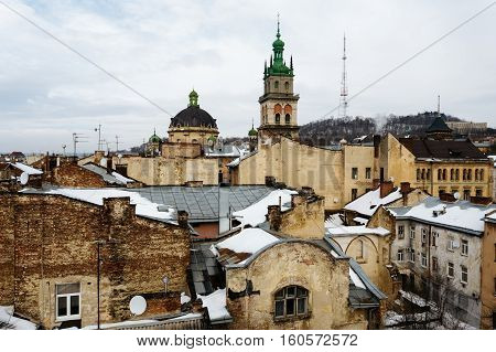 Dormition Church above the old houses in the center of Lviv, Ukraine in winter day