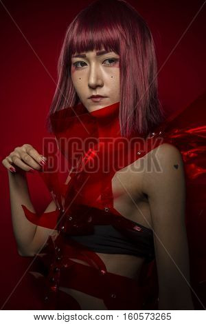 Character Oriental girl with red plastic costume, futuristic cosplay costumes