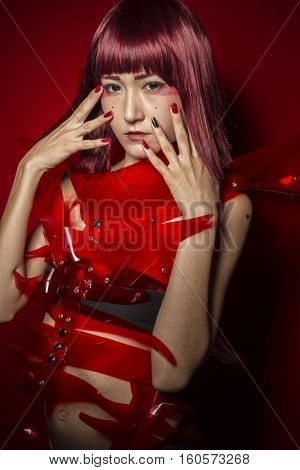 Oriental girl with red plastic costume, futuristic cosplay costumes