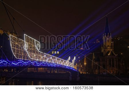 Lyon, France, December 7, 2016 : A Light Boat On The Pedestrian Bridge Over Saone River. The Festiva