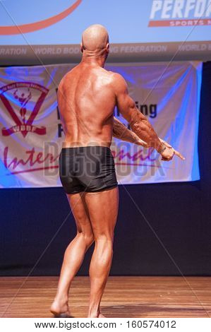 MAASTRICHT THE NETHERLANDS - OCTOBER 25 2015: Male bodybuilder Erik Stobbe shows his best back pose at the World Grandprix Bodybuilding and Fitness of the WBBF-WFF