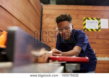 Carpenter Using Plane In Woodworking Woodshop
