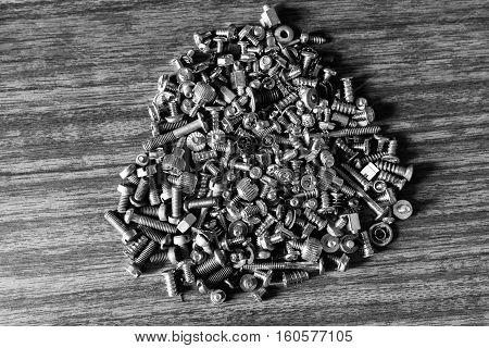 Male screws and female screws on workshop desk tools background hd