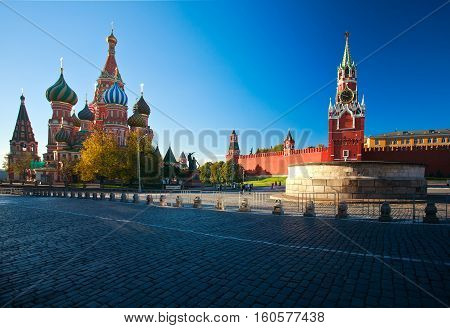 Intercession Cathedral St. Basil's and the Spassky Tower of Moscow Kremlin at Red Square in Moscow. Russia.