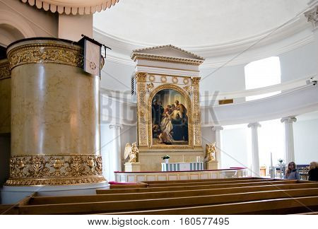 Helsinki, Finland - April 10, 2010: People in interior of The City Cathedral near altar with
