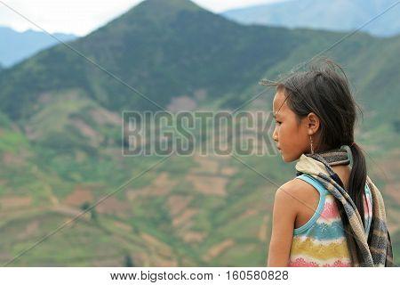 YEN BAI, VIETNAM - MAY 22, 2010: Portrait of an unidentified Vietnamese minority girl in the mountain area of Mu Cang Chai district.