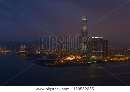 One Island East Centre on coast in business area at night in Hong Kong, China, view from China Merchants Tower