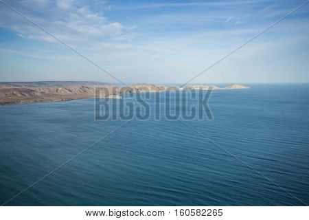 Beautiful sea, waterside, clouds and blue water at summer sunny day