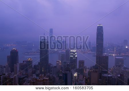 Night view of city in fog and Victoria Harbour in Hong Kong, China, view from Queen Garden