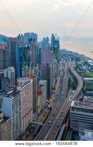 Skyscrapers, highway on shore in business area at morning in Hong Kong, China, view from China Merchants Tower