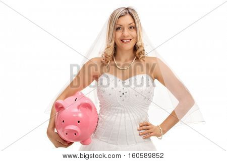 Happy bride with a piggybank isolated on white background