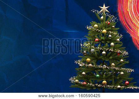 Decorated Christmass Tree on Blue Background with Copy-space