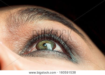 Senior man with green striped color lens in eye and bushy eyebrows with eyelashes on old wrinkled face