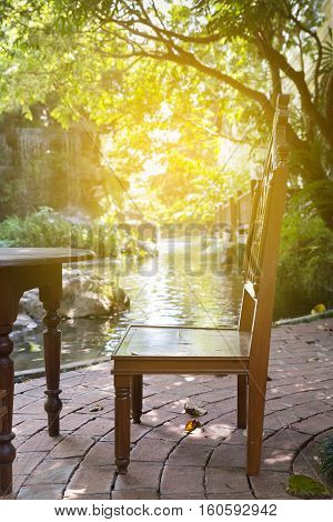 Wood Chair And Table At Waterside Of Pond