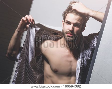 Handsome Man Shows Muscle Torso