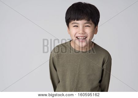East asian boy studio portrait - isolation