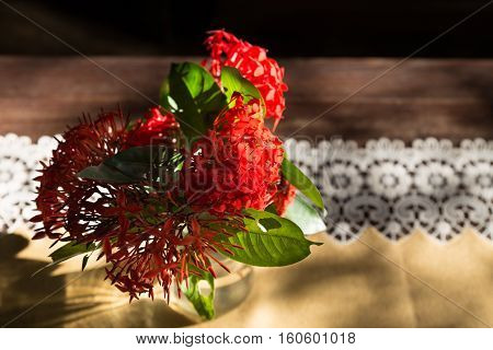 Ixora Flower In Vase On Wood Table