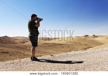 Nature photographer taking photos in the desert