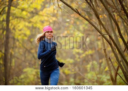 Beautiful woman running in morning